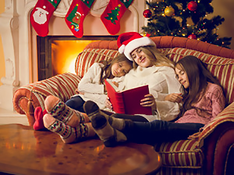 woman and two daughters fell asleep at fireplace during holidays
