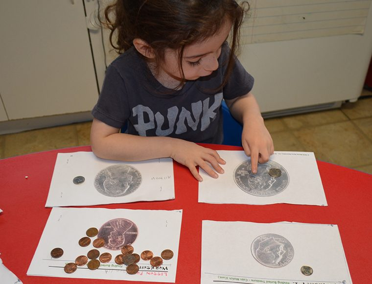 WA Preschooler doing coin match - cropped(ABCKidCare)-760pix