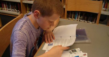 Boy studying MSU Cash Cache