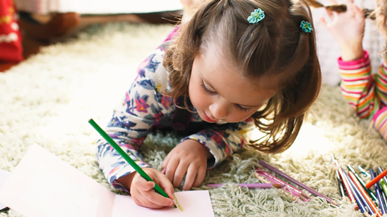 Young girl writing a thank you card