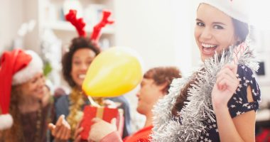 secret-santa-gift-ideas-girl wearing garland at party