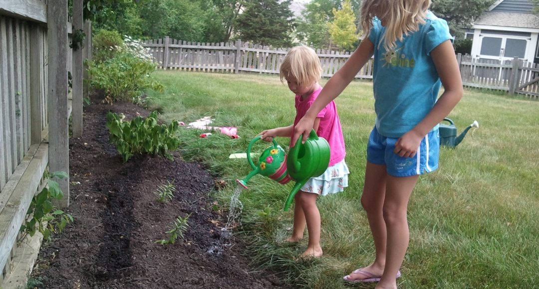 Girls Watering Garden