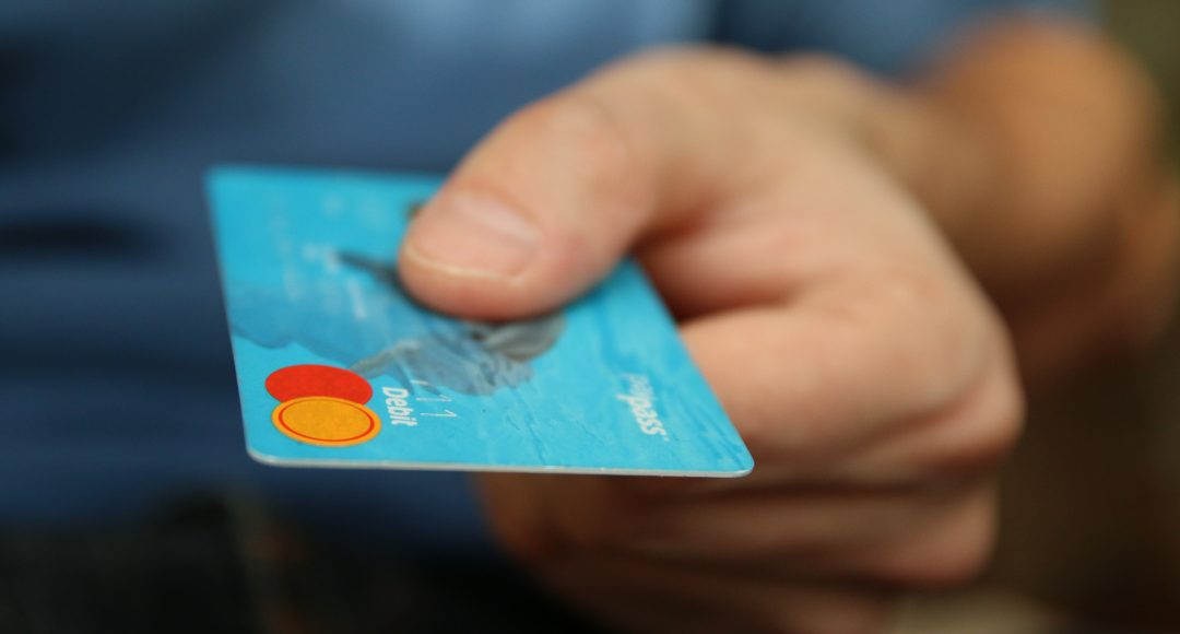 Consumer-presenting-Credit-Card-